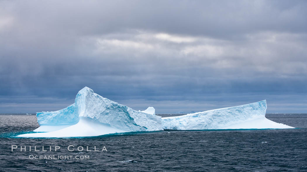 Iceberg, ocean, light and clouds.  Light plays over icebergs and the ocean near Coronation Island. Coronation Island, South Orkney Islands, Southern Ocean, natural history stock photograph, photo id 24779