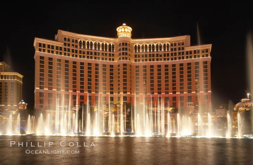The Bellagio Hotel fountains, at night.  The Bellagio Hotel fountains are one of the most popular attractions in Las Vegas, showing every half hour or so throughout the day, choreographed to famous Hollywood music.,  Copyright Phillip Colla, image #20557, all rights reserved worldwide.
