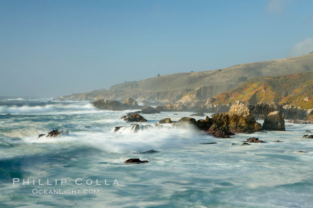 Waves blur as they break over the rocky shoreline of Big Sur.,  Copyright Phillip Colla, image #14904, all rights reserved worldwide.