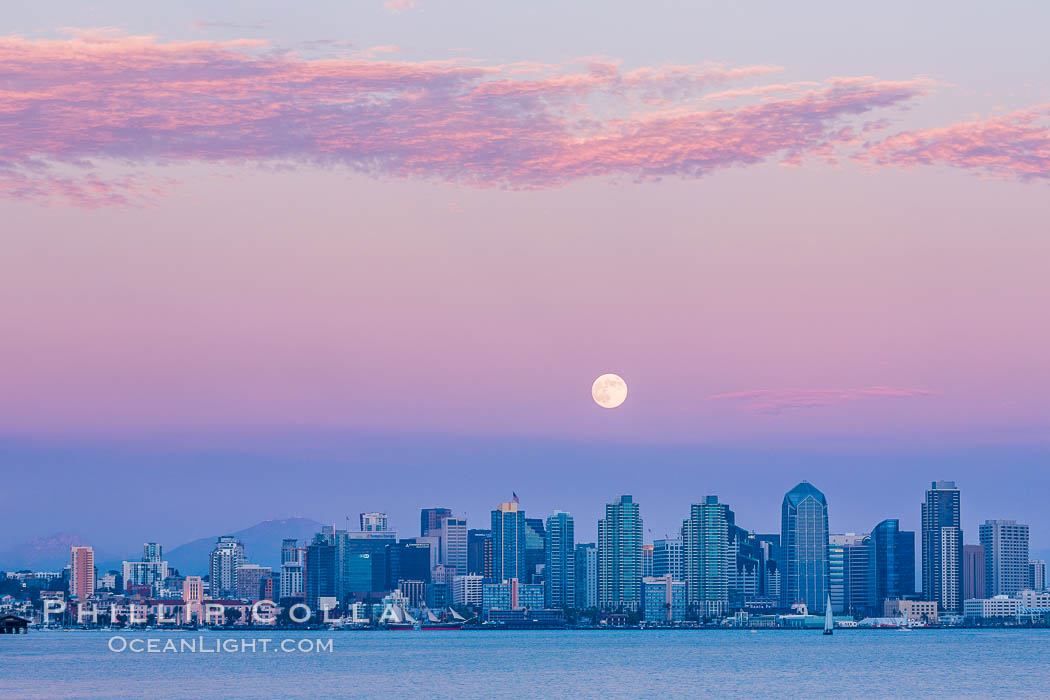 "Blue Moon at Sunset over San Diego City Skyline.  The third full moon in a season, this rare ""blue moon"" rises over San Diego just after sundown"