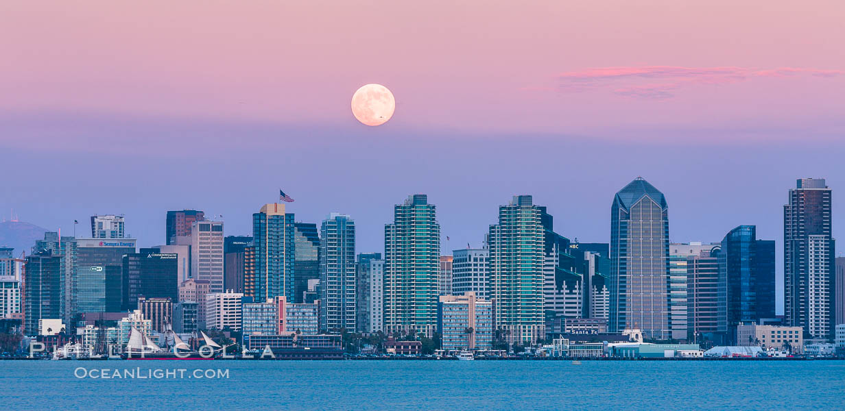 Blue Moon Full At Sunset Over San Diego City Skyline Approaching Jet With