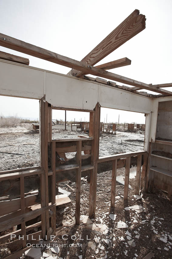 Bombay Beach, lies alongside and below the flood level of the Salton Sea, so that it floods occasionally when the Salton Sea rises.  A part of Bombay Beach is composed of derelict old trailer homes, shacks and wharfs, slowly sinking in the mud and salt. Salton Sea, Imperial County, California, USA, natural history stock photograph, photo id 22501