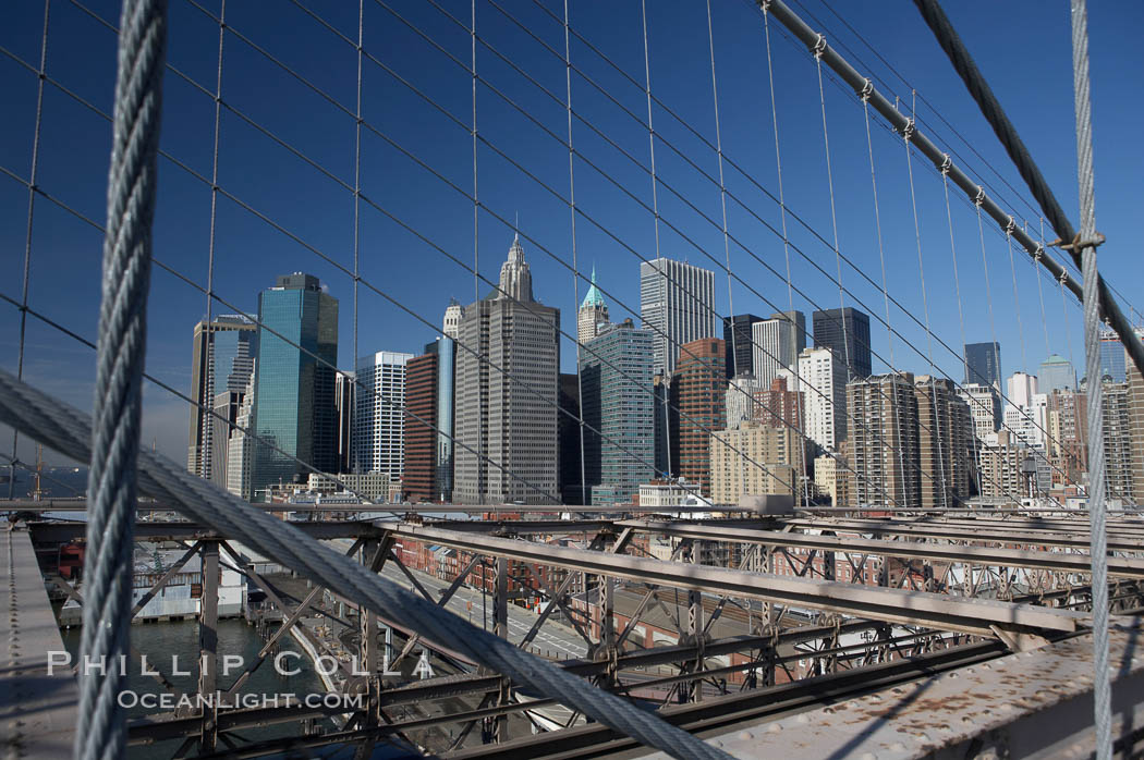 Lower Manhattan skyline viewed from the Brooklyn Bridge.,  Copyright Phillip Colla, image #11094, all rights reserved worldwide.