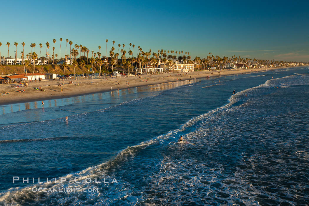 The coast of Oceanside California, waves and surfers, beach houses, just before sunset, winter, looking south. Oceanside Pier, USA, natural history stock photograph, photo id 27599