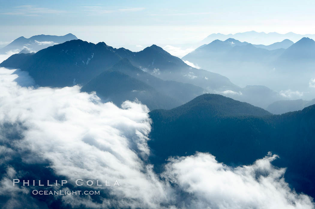 Coastal mountains and clouds, rising above Bedwell Sound (hidden by clouds) and Clayoquot Sound, near Tofino on the west coast of Vancouver Island. Tofino, British Columbia, Canada, natural history stock photograph, photo id 21093