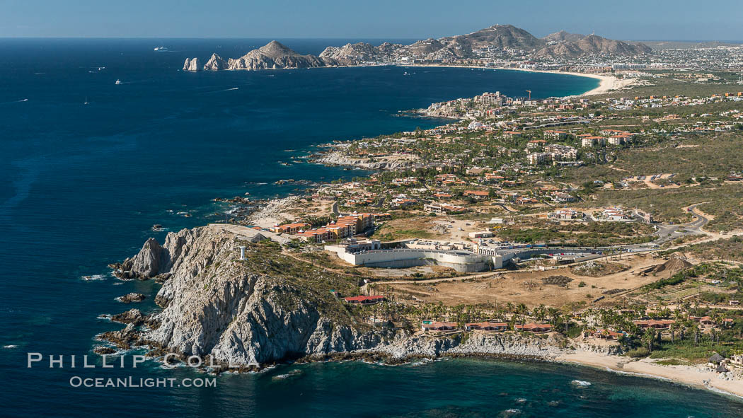 Punta Ballena, Faro Cabesa Ballena (foreground), Medano Beach and Land's End (distance). Residential and resort development along the coast near Cabo San Lucas, Mexico