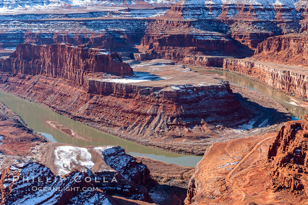 Dead Horse Point Overlook, with the Colorado River flowing 2,000 feet below.  300 million years of erosion has carved the expansive canyons, cliffs and walls below and surrounding Deadhorse Point. Deadhorse Point State Park, Utah, USA, natural history stock photograph, photo id 18091