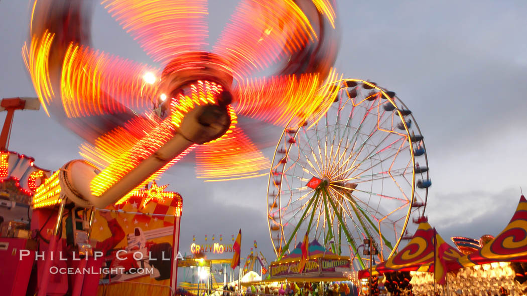 Ferris wheel and fair rides at sunset, blurring due to long exposure. Del Mar Fair, Del Mar, California, USA, natural history stock photograph, photo id 20872