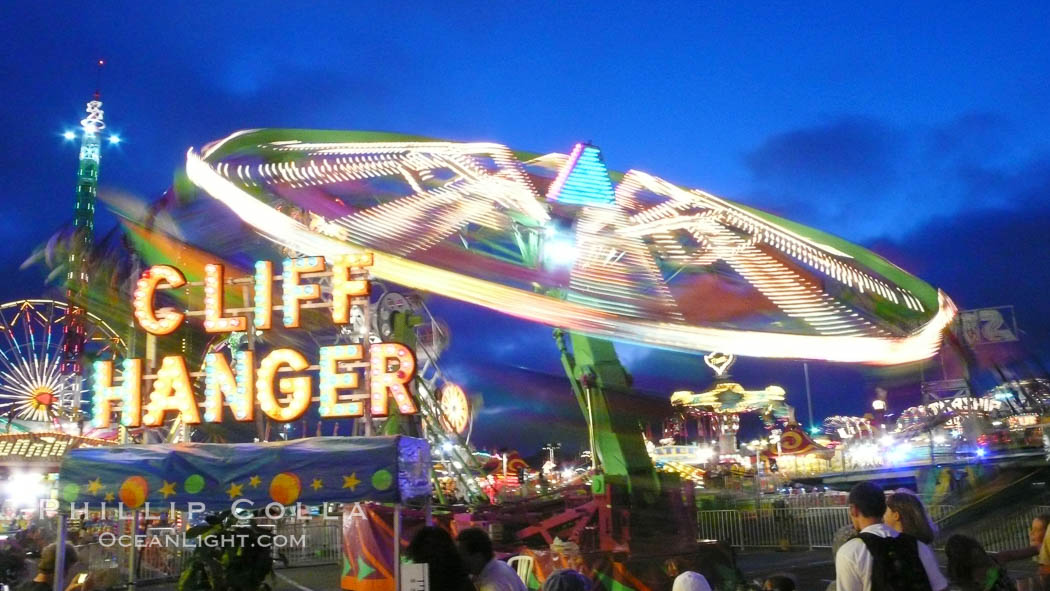 Del Mar Fair rides at night, blurring due to long exposure. Del Mar Fair, Del Mar, California, USA, natural history stock photograph, photo id 20876
