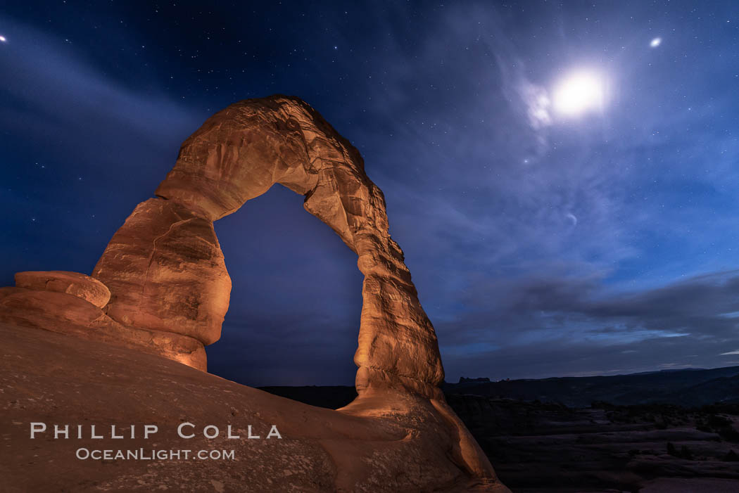 Delicate Arch with Stars and Moon, at night, Arches National Park. Utah, USA, natural history stock photograph, photo id 29286