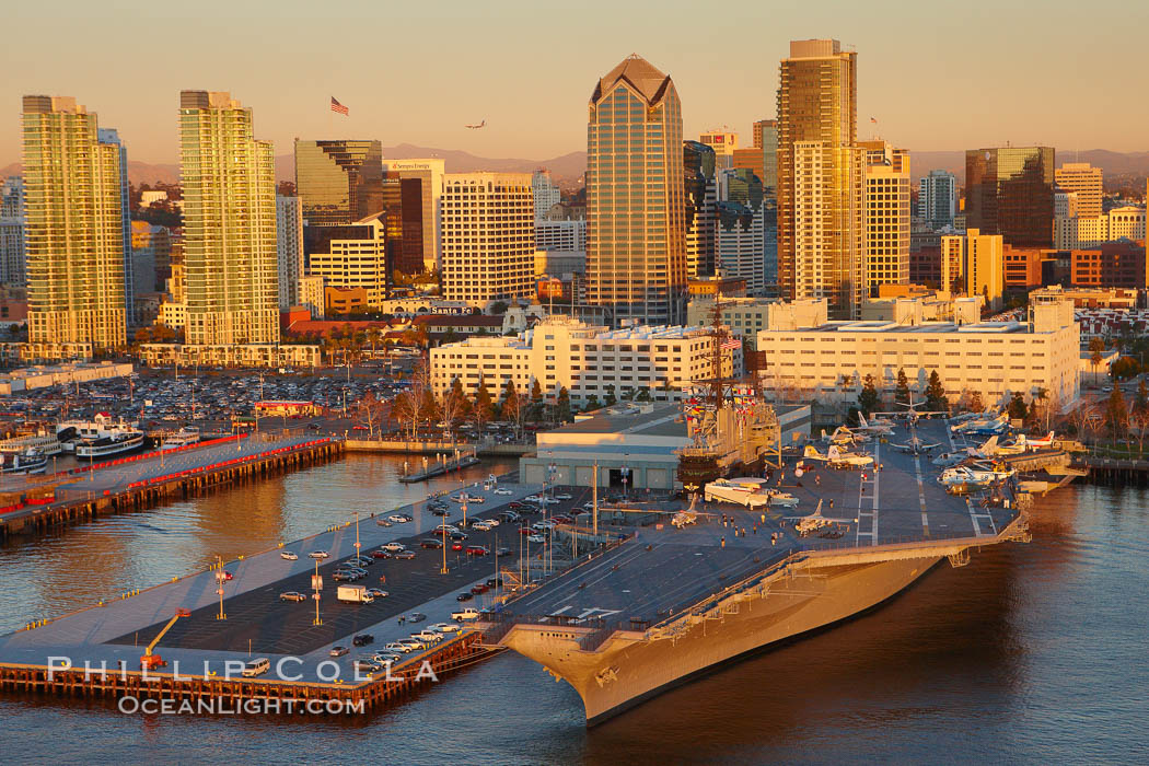 Downtown San Diego and USS Midway.  The USS Midway was a US Navy aircraft carrier, launched in 1945 and active through the Vietnam War and Operation Desert Storm, as of 2008 a museum along the downtown waterfront in San Diego. San Diego, California, USA, natural history stock photograph, photo id 22389