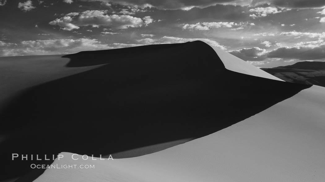 "Eureka Sand Dunes, infrared black and white.  The Eureka Dunes are California's tallest sand dunes, and one of the tallest in the United States.  Rising 680' above the floor of the Eureka Valley, the Eureka sand dunes are home to several endangered species, as well as ""singing sand"" that makes strange sounds when it shifts. Eureka Dunes, Death Valley National Park, California, USA, natural history stock photograph, photo id 25379"