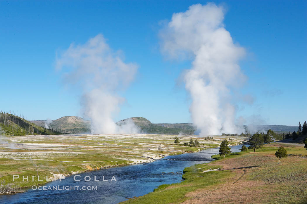 Steam rises above the Midway Geyser Basin, largely from Grand Prismatic Spring and Excelsior Geyser. The Firehole River flows by. Midway Geyser Basin, Yellowstone National Park, Wyoming, USA, natural history stock photograph, photo id 13605