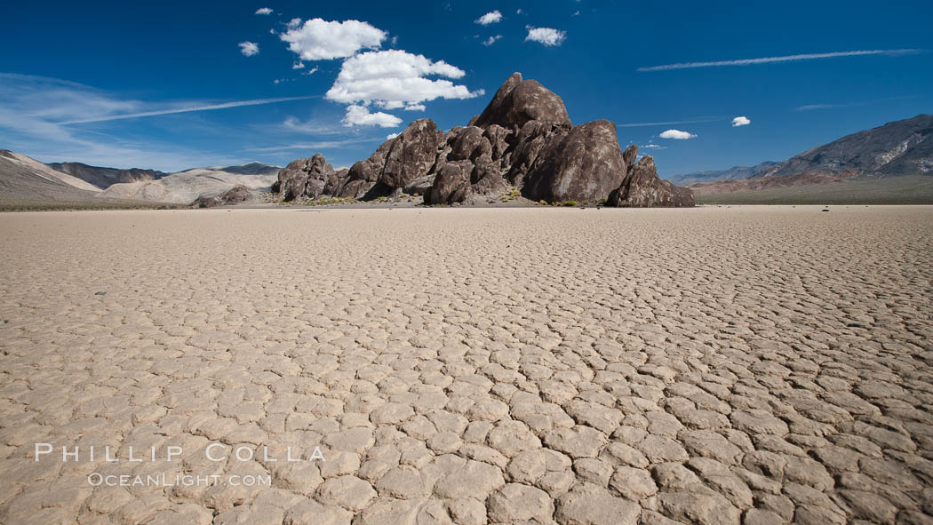 The Grandstand, standing above dried mud flats, on the Racetrack Playa in Death Valley. Racetrack Playa, Death Valley National Park, California, USA, natural history stock photograph, photo id 25313