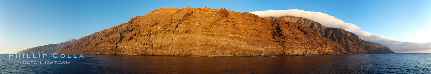 Guadalupe Island at sunrise, panorama.  Volcanic coastline south of Pilot Rock and Spanish Cove, near El Faro lighthouse, Guadalupe Island (Isla Guadalupe)