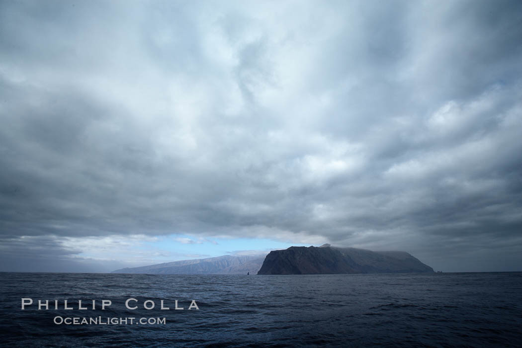 Guadalupe Island, dark and gloomy clouds, northern approach.,  Copyright Phillip Colla, image #21369, all rights reserved worldwide.
