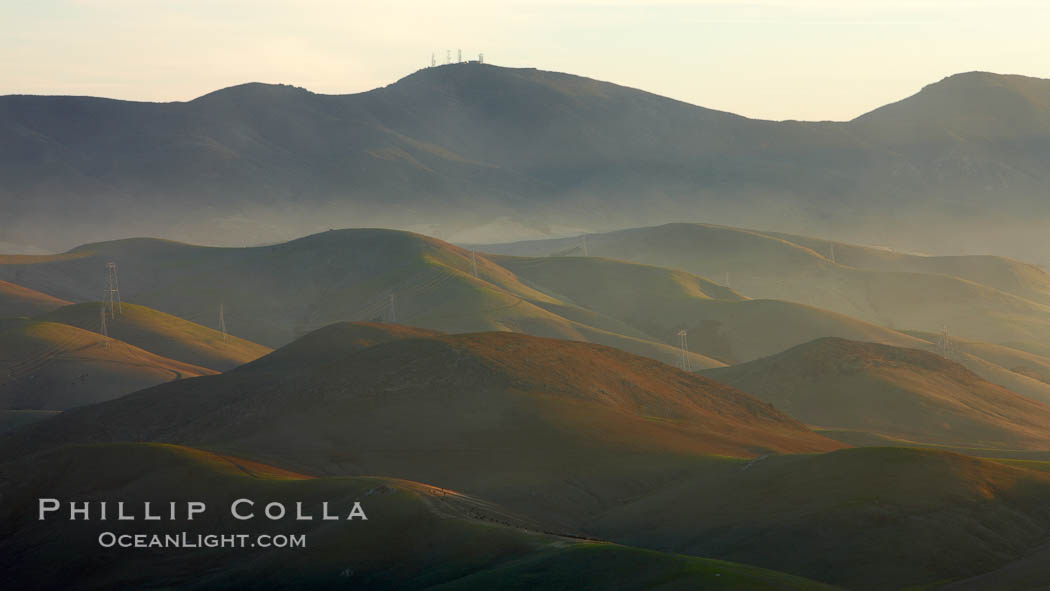 Hills between Morro Bay and Atascadero, early morning light, power transmission lines and signal attenae.,  Copyright Phillip Colla, image #22222, all rights reserved worldwide.