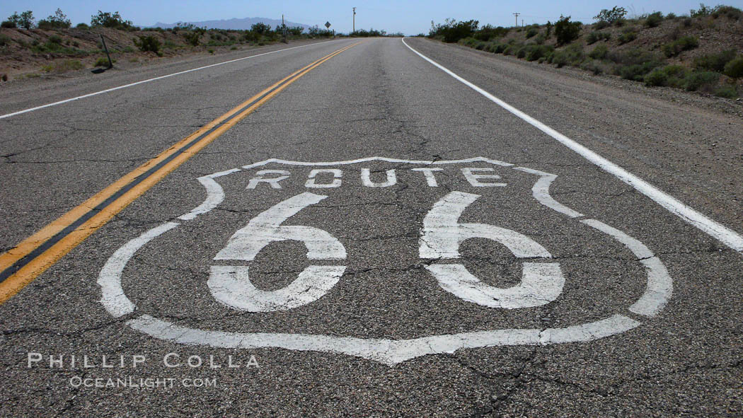 Route 66 (also known as U.S. Route 66, The Main Street of America, The Mother Road and the Will Rogers Highway) was a highway in the U.S. Highway system. One of the original federal routes, US 66 was established in 1926 and originally ran from Chicago through Missouri, Kansas, Oklahoma, Texas, New Mexico, Arizona, and California, before ending at Los Angeles for a total of 2,448 miles.  US 66 was officially decommissioned (i.e., removed from the offical U.S. Highway system) in 1985 after it was decided the route was no longer relevant and had been replaced by the Interstate Highway System. ,  Copyright Phillip Colla, image #20567, all rights reserved worldwide.