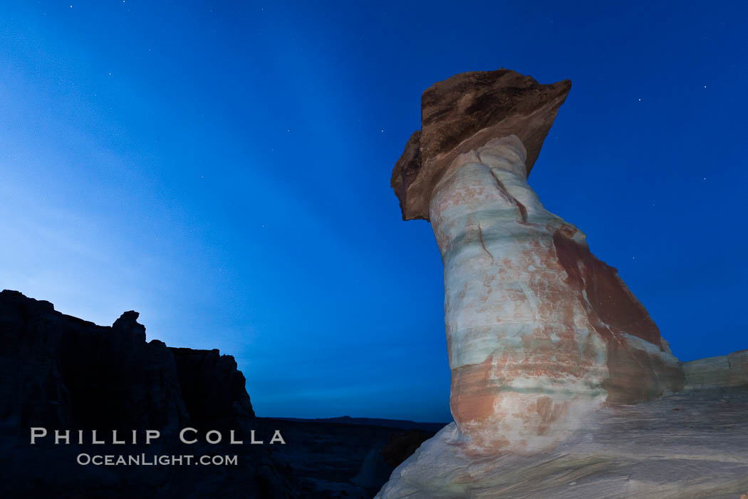 Pedestal rock, or hoodoo, at Stud Horse Point.  These hoodoos form when erosion occurs around but not underneath a more resistant caprock that sits atop of the hoodoo spire. Stud Horse Point, Page, Arizona, USA, natural history stock photograph, photo id 26623