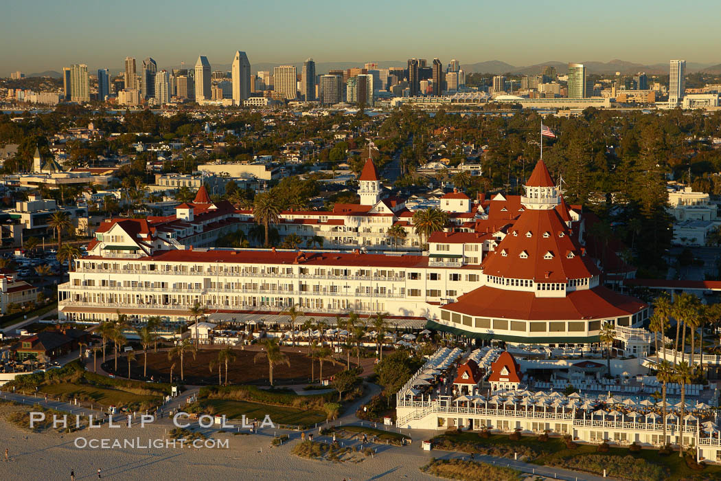 Image 22287, Hotel del Coronado, known affectionately as the Hotel Del.  It was once the largest hotel in the world, and is one of the few remaining wooden Victorian beach resorts.  It sits on the beach on Coronado Island, seen here with downtown San Diego in the distance.  It is widely considered to be one of Americas most beautiful and classic hotels. Built in 1888, it was designated a National Historic Landmark in 1977. San Diego, California, USA
