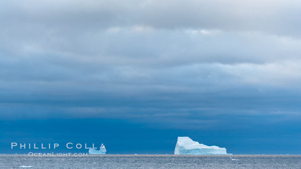 Iceberg, ocean, light and clouds.  Light plays over icebergs and the ocean near Coronation Island. Coronation Island, South Orkney Islands, Southern Ocean, natural history stock photograph, photo id 24797