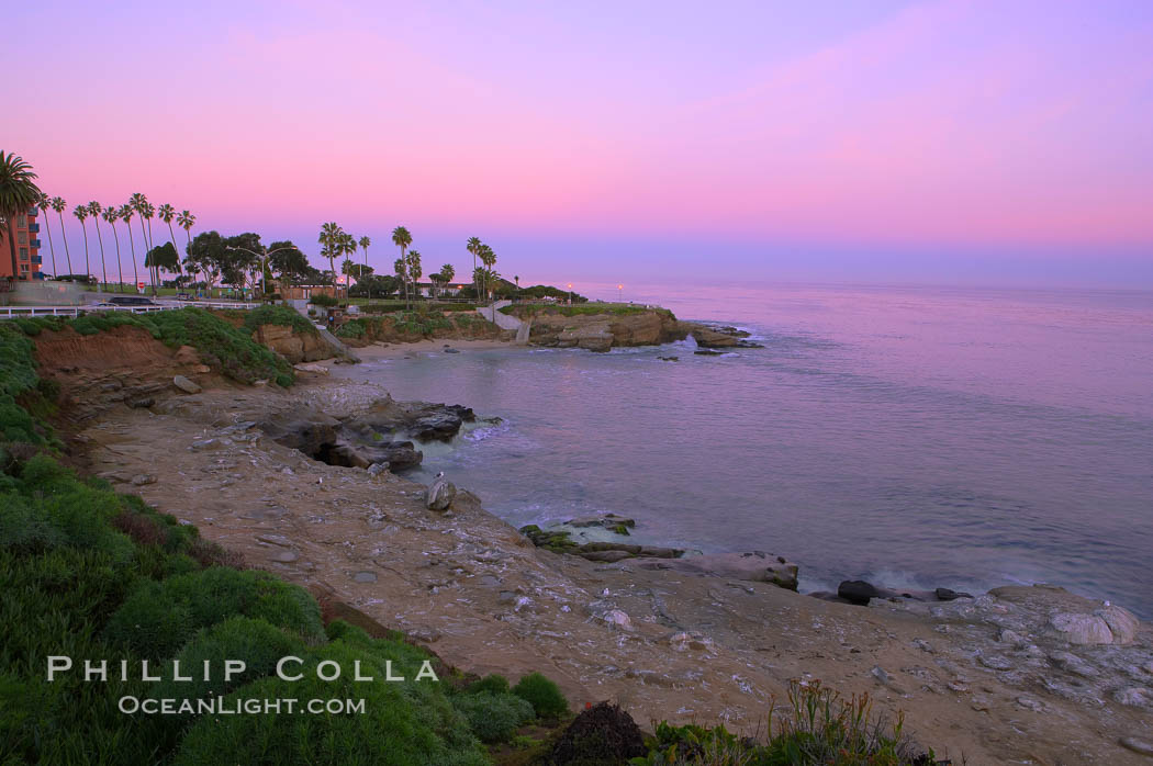 La Jolla Cove meets the dawn with pink skies and a flat ocean.,  Copyright Phillip Colla, image #20251, all rights reserved worldwide.