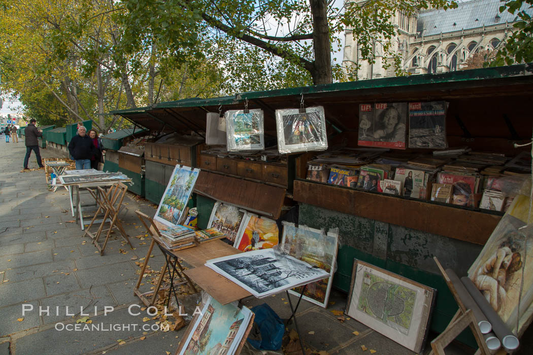 Art Seller along La Rive Gauche, the Left Bank, Paris. La Rive Gauch, the Left Bank, is the southern bank of the river Seine in Paris. Here the river flows roughly westward, cutting the city in two: looking downstream, the southern bank is to the left, and the northern bank (or Rive Droite) is to the right