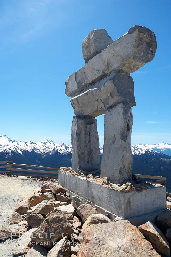 Ilanaaq, the logo of the 2010 Winter Olympics in Vancouver, is formed of stone in the Inukshuk-style of traditional Inuit sculpture.  This one is located on the summit of Whistler Mountain. British Columbia, Canada, natural history stock photograph, photo id 21019