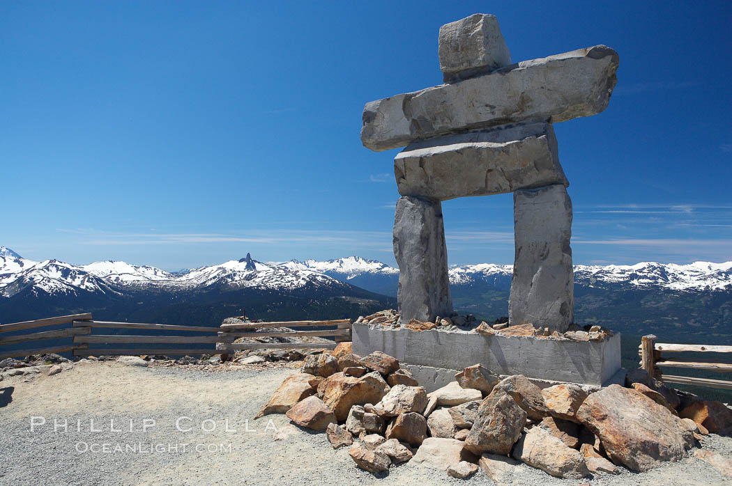 Ilanaaq, the logo of the 2010 Winter Olympics in Vancouver, is formed of stone in the Inukshuk-style of traditional Inuit sculpture.  This one is located on the summit of Whistler Mountain. British Columbia, Canada, natural history stock photograph, photo id 21017
