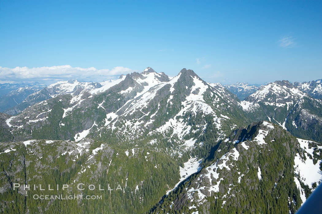 Mariner Mountain, viewed from the northwest, on the west coast of Vancouver Island, British Columbia, Canada, part of Strathcona Provincial Park, located 36 km (22 mi) north of Tofino.  It is 1,771 m (5,810 ft) high, snow covered year-round and home to several glaciers., natural history stock photograph, photo id 21071