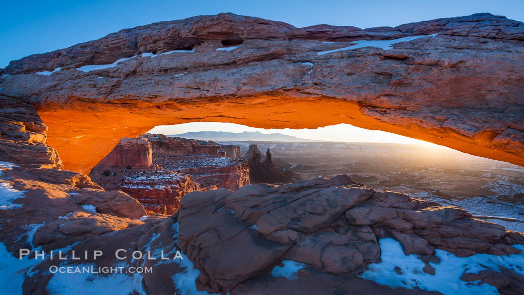Mesa Arch spans 90 feet and stands at the edge of a mesa precipice thousands of feet above the Colorado River gorge. For a few moments at sunrise the underside of the arch glows dramatically red and orange. Island in the Sky, Canyonlands National Park, Utah, USA, natural history stock photograph, photo id 18040