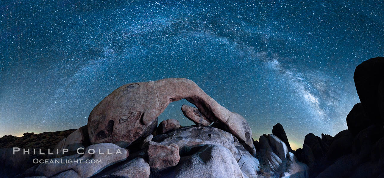 The Milky Way galaxy arcs above Arch Rock, panoramic photograph, cylindrical projection. Joshua Tree National Park, California, USA, natural history stock photograph, photo id 26850