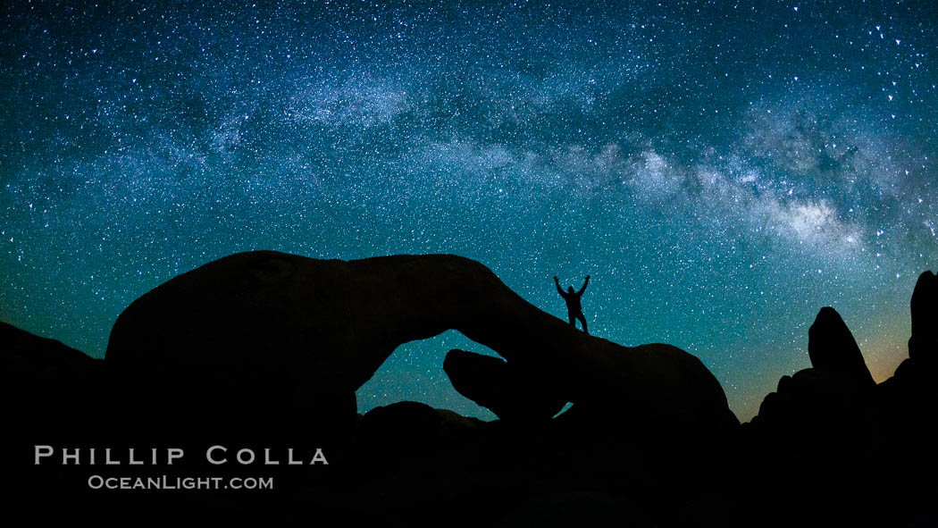 The Milky Way galaxy arches over Arch Rock on a clear evening in Joshua Tree National Park