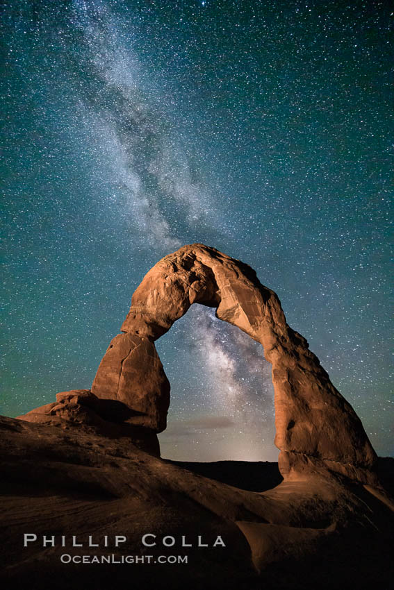 Milky Way arches over Delicate Arch, as stars cover the night sky, Arches National Park, Utah