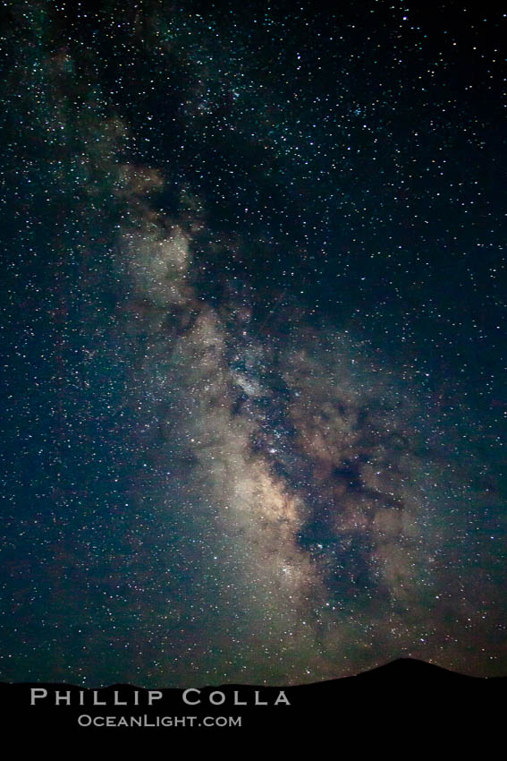 The Galactic Center of the Milky Way galaxy rises in the sky on a clear night. Milky Way Galaxy, The Universe, natural history stock photograph, photo id 25246