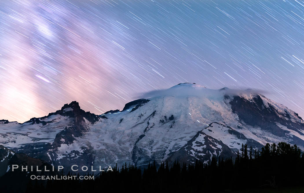 Moutain climbers light see upon Mount Rainier, Milky Way and stars at night above Mount Rainier, Sunrise, Mount Rainier National Park, Washington