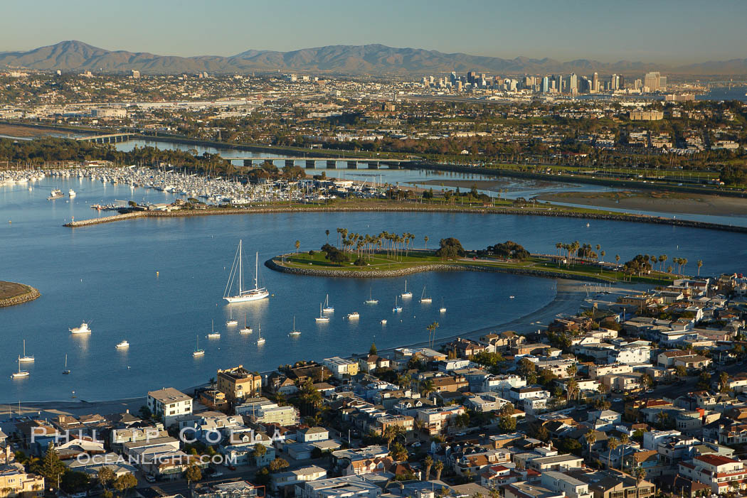 "Mission Bay is the largest man-made aquatic park in the country.  It spans 4,235 acres and is split nearly evenly between land and water.  It is situated between the communities of Pacific Beach, Mission Beach, Bay Park and bordered on the south by the San Diego River channel.  Once named ""False Bay"" by Juan Cabrillo in 1542, the tidelands were dredged in the 1940's creating the basins and islands of what is now Mission Bay. San Diego, California, USA, natural history stock photograph, photo id 22324"