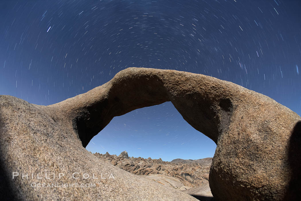 Mobius Arch in the Alabama Hills, seen here at night with swirling star trails formed in the sky above due to a long time exposure. Alabama Hills Recreational Area, California, USA, natural history stock photograph, photo id 21744