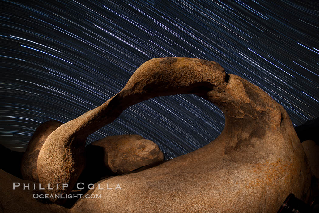 Mobius Arch in the Alabama Hills, seen here at night with swirling star trails formed in the sky above due to a long time exposure. Alabama Hills Recreational Area, California, USA, natural history stock photograph, photo id 27679