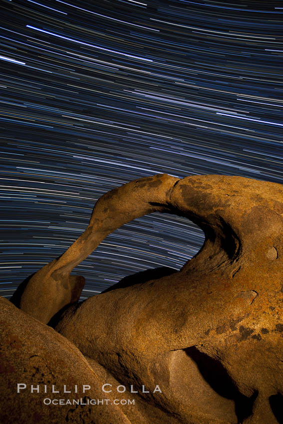 Mobius Arch in the Alabama Hills, seen here at night with swirling star trails formed in the sky above due to a long time exposure. Alabama Hills Recreational Area, California, USA, natural history stock photograph, photo id 27673