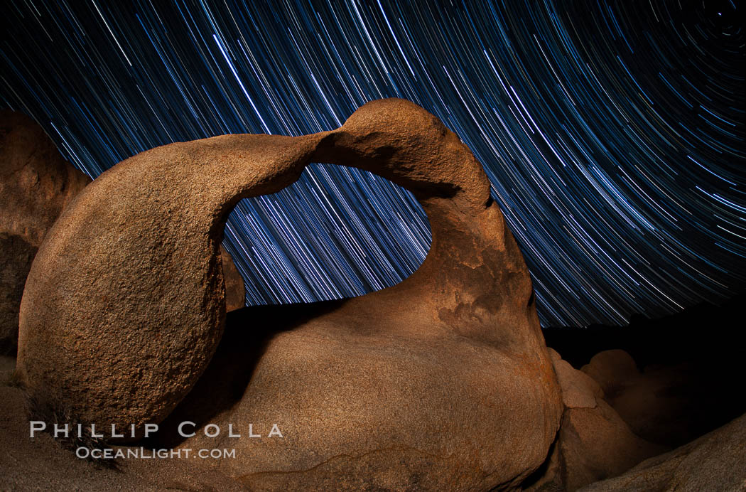 Mobius Arch in the Alabama Hills, seen here at night with swirling star trails formed in the sky above due to a long time exposure. Polaris, the North Star, is visible at upper right. Alabama Hills Recreational Area, California, USA, natural history stock photograph, photo id 27677