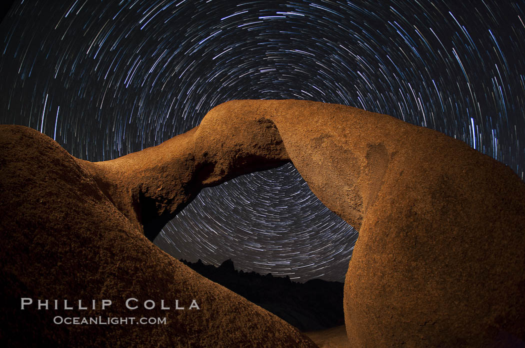 Mobius Arch in the Alabama Hills, seen here at night with swirling star trails formed in the sky above due to a long time exposure. Alabama Hills Recreational Area, California, USA, natural history stock photograph, photo id 27681