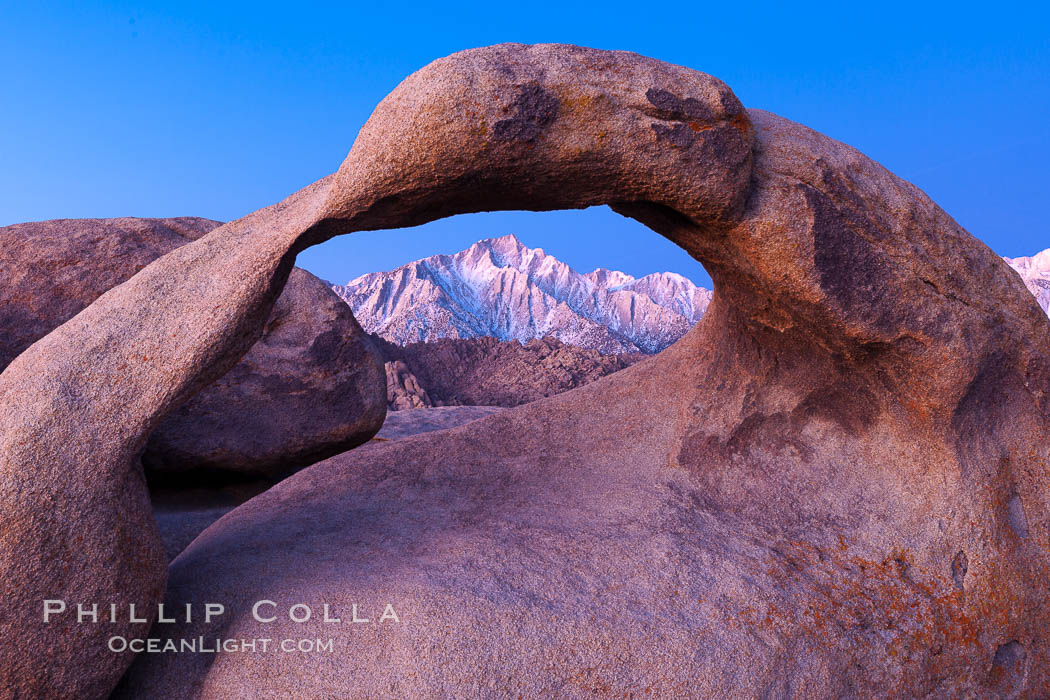 Mobius Arch at sunrise, framing snow dusted Lone Pine Peak and the Sierra Nevada Range in the background. Also known as Galen's Arch, Mobius Arch is found in the Alabama Hills Recreational Area near Lone Pine. Alabama Hills Recreational Area, California, USA, natural history stock photograph, photo id 27622