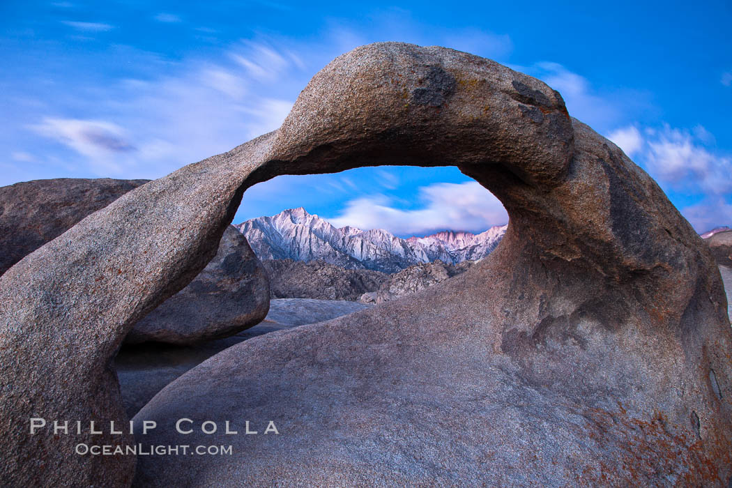 Mobius Arch at sunrise, framing snow dusted Lone Pine Peak and the Sierra Nevada Range in the background. Also known as Galen's Arch, Mobius Arch is found in the Alabama Hills Recreational Area near Lone Pine. Alabama Hills Recreational Area, California, USA, natural history stock photograph, photo id 27644
