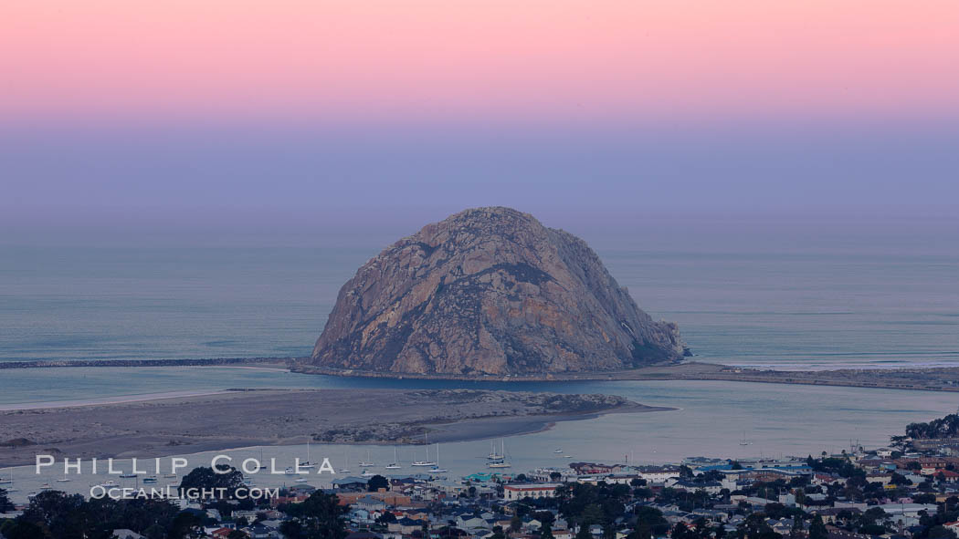 Earth shadow over Morro Rock and Morro Bay.  Just before sunrise the shadow of the Earth can seen as the darker sky below the pink sunrise