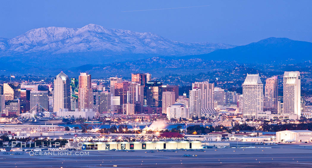 Dusk settles on downtown San Diego with snow-covered Mt. Laguna in the distance