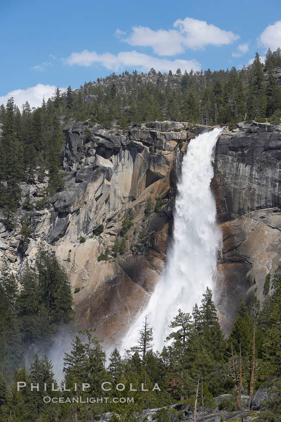 Nevada Falls marks where the Merced River plummets almost 600 through a joint in the Little Yosemite Valley, shooting out from a sheer granite cliff and then down to a boulder pile far below.,  Copyright Phillip Colla, image #16114, all rights reserved worldwide.