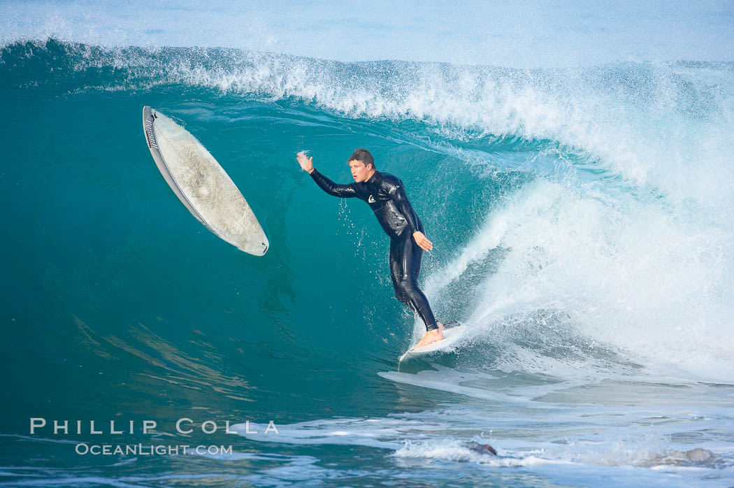 Surfer nearly collides with stray board, #3 of a 6 frame sequence, Newport Beach