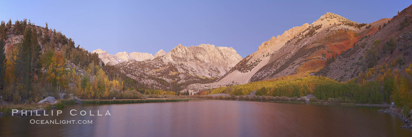 North Lake lit by alpenglow before sunrise, a three frame panorama, with groves of yellow and orange aspen trees on the side of Paiute Peak. Bishop Creek Canyon, Sierra Nevada Mountains, Bishop, California, USA, natural history stock photograph, photo id 23336