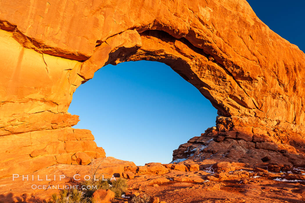 North Window glows red at sunset.  North Window is a natural sandstone arch 90 feet wide and 48 feet high. North Window, Arches National Park, Utah, Utah, USA, natural history stock photograph, photo id 18169